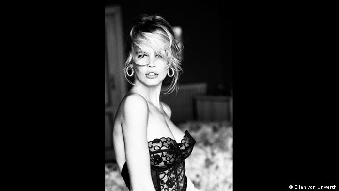 woman in a bustier facing the camera (Ellen von Unwerth)