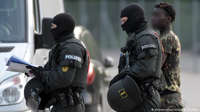 German police carry out a deportation