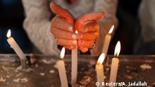 02.05.2018 *** A Jewish woman lights candles inside the Ghriba synagogue in Djerba, Tunisia May 2, 2018. REUTERS/Ahmed Jadallah