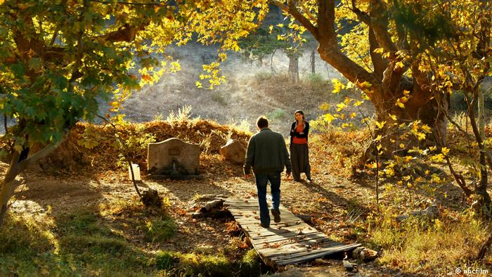 The Turkish film entry shows a couple talking in a garden (nbcfilm)