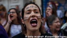 MADRID, SPAIN - APRIL 26: A protester shouts slogans as she wears face paint reading 'No is no' during a demonstration against the verdict of the 'La Manada' (Wolf Pack) gang case outside the Minister of Justice on April 26, 2018 in Madrid, Spain. The High Court of Navarra has given a sentence of 9 years in prison to five men for 'continued sexual abuse' instead of 'rape', which would have seen them recieve around 22 years in prison. The gang assaulted an 18-year-old woman in Pamplona, during the San Fermin Festival in 2016. Feminists and women's rights groups have called for demonstrations across Spain. (Photo by Pablo Blazquez Dominguez/Getty Images)