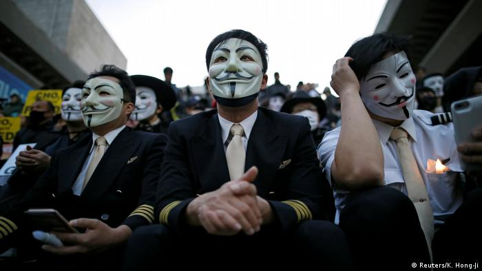 Pilots of Korean Air protest wearing Guy Fawkes masks (Reuters/K. Hong-Ji)