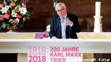 EU Commission President Jean-Claude Juncker speaks during Karl Marx 200th anniversary celebrations at the Basilica of Constantine in Trier, Germany, May 4, 2018. REUTERS/Wolfgang Rattay