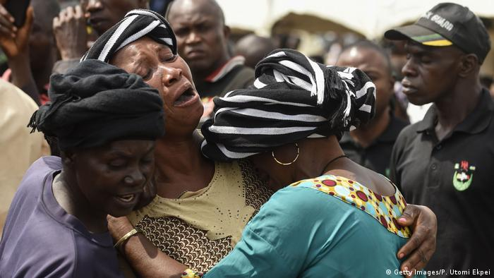 Three women hug, grieving (Getty Images/P. Utomi Ekpei)