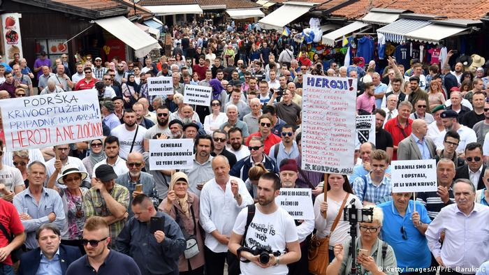 Protesters in hold-up signs in Sarajevo