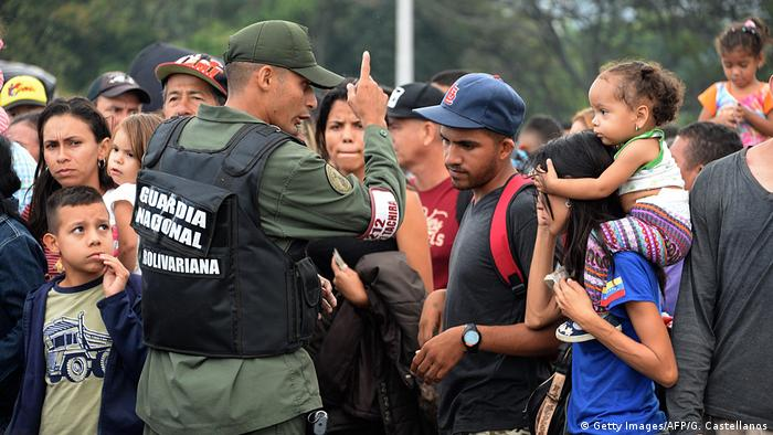 Venezuelan citizens cross the Simon Bolivar international bridge from San Antonio del Tachira in Venezuela to Norte de Santander province of Colombia