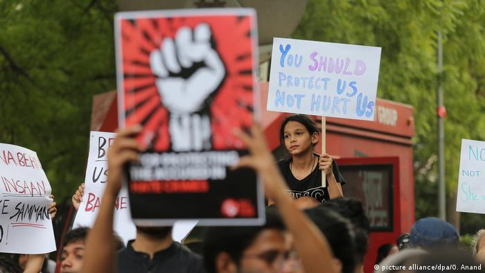A girl holding a placard during a protest in New Delhi against sexual violence