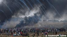 Tear gas canisters are fired by Israeli forces at Palestinian demonstrators during a protest demanding the right to return to their homeland, at the Israel-Gaza border, east of Gaza City, May 4, 2018. REUTERS/Mohammed Salem TPX IMAGES OF THE DAY