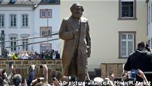 A bronze statue showing German philosopher Karl Marx was unveiled on occasion of the 200th birthday of Marx in Trier, Germany, Saturday, May 5, 2018. The statue was created bY Chinese artist Wu Weishan and is a present of China. (AP Photo/Michael Probst) |