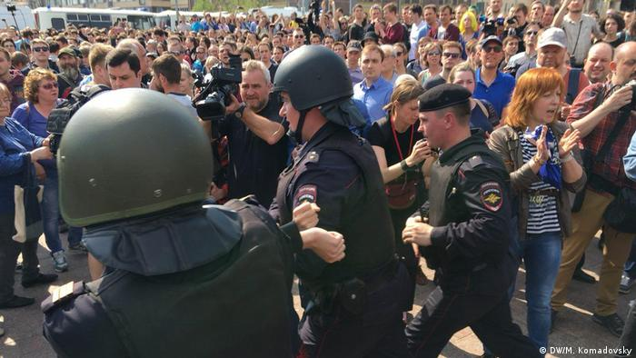Police confront protesters in Moscow.