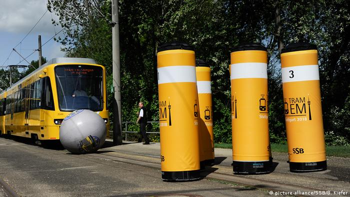 A tram heads for a large bowling ball