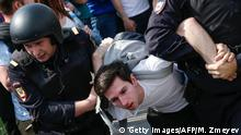 Russian police officers detain a participant of an unauthorized anti-Putin rally called by opposition leader Alexei Navalny on May 5, 2018 in Moscow, two days ahead of Vladimir Putin's inauguration for a fourth Kremlin term. (Photo by Maxim ZMEYEV / AFP) (Photo credit should read MAXIM ZMEYEV/AFP/Getty Images)