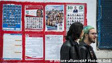 People walk past electoral posters in l'Ariana, outside Tunis, Friday, May 4 2018. Tunisia is hoping to break through barriers with its first local elections since its Arab Spring revolution: They could bring the first woman mayor of the capital, the first Jewish official with an Islamist party and new flock of mayors with greater powers. (AP Photo/Hassene Dridi) |