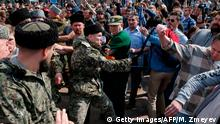 5.5.2018*** TOPSHOT - Cossacks scuffle with opposition supporters during an unauthorized anti-Putin rally called by opposition leader Alexei Navalny on May 5, 2018 in Moscow, two days ahead of Vladimir Putin's inauguration for a fourth Kremlin term. (Photo by Maxim ZMEYEV / AFP) (Photo credit should read MAXIM ZMEYEV/AFP/Getty Images)