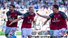 SANDHAUSEN, GERMANY - MAY 06: Hanno Behrens of Nuernberg celebrates his team's first goal with team mate Enrico Valentini (L) during the Second Bundesliga match between SV Sandhausen and 1. FC Nuernberg at BWT-Stadion am Hardtwald on May 6, 2018 in Sandhausen, Germany. (Photo by Simon Hofmann/Bongarts/Getty Images)