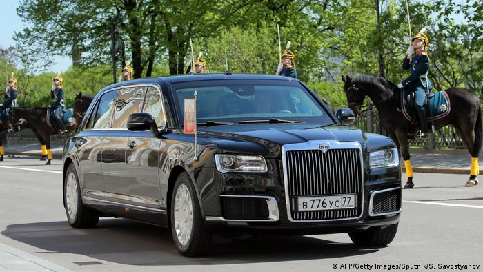 A picture of Vladimir Putin driving thenew Russian-made limousine