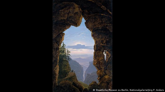 Karl Friedrich Schinkel painting shows a view of mountains between a rock arch (Staatliche Museen zu Berlin, Nationalgalerie/Jörg P. Anders)