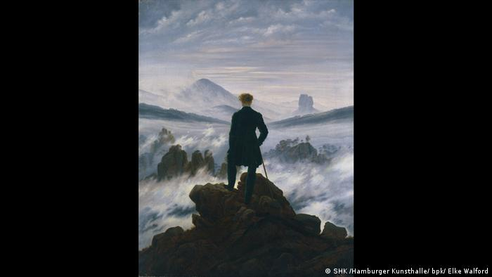 Caspar David Friedrich painting shows a man looking out at a mountainous horizon (SHK /Hamburger Kunsthalle/ bpk/ Elke Walford)