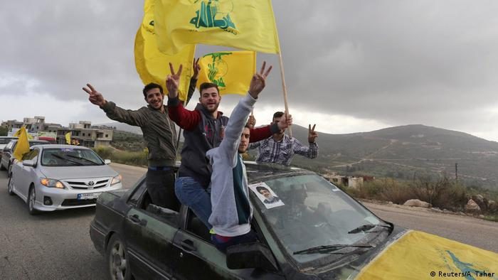 Supporters of Lebanon's Hezbollah leader Sayyed Hassan Nasrallah hold Hezbollah flags