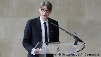Curator Andrew Bolton speaks at a glass podium (Getty Images/J. Countness)