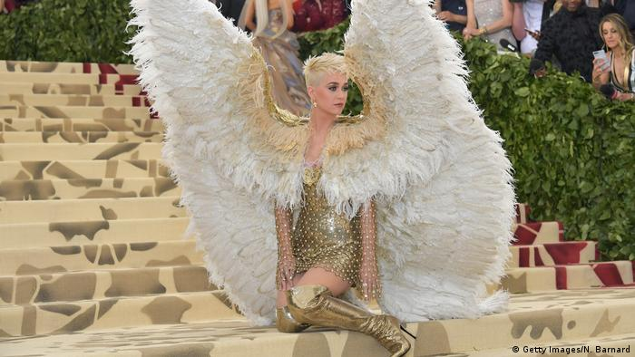 Adorned in gold thigh-high boots and six-foot feathered wings is a blonde Katy Perry (Getty Images/N. Barnard)