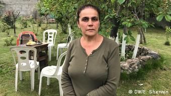Former market vendor Anahit Pkhrikyan poses in her garden in Yerevan