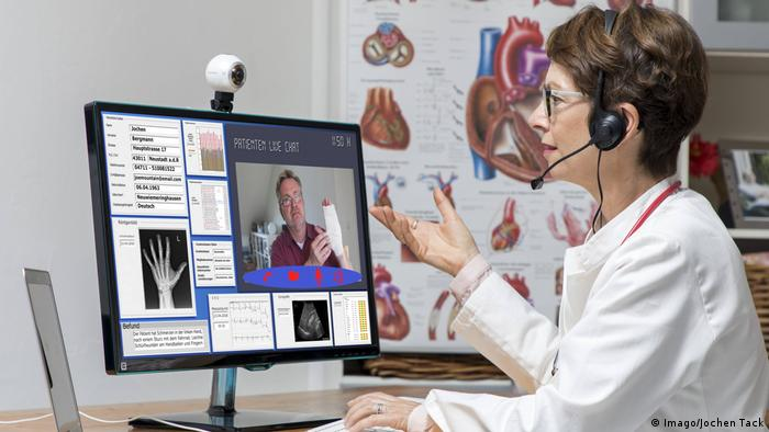 Doctor communicating with patient online