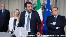 League party leader Matteo Salvini (C) speaks next to President of Fratelli d'Italia party (Brothers of Italy) Giorgia Meloni (L) and Forza Italia leader Silvio Berlusconi following a talk with Italian President Sergio Mattarella at the Quirinale palace in Rome, Italy, May 7, 2018. Italian Presidential Press Office/Handout via REUTERS ATTENTION EDITORS - THIS IMAGE WAS PROVIDED BY A THIRD PARTY.