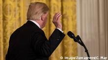 April 3, 2018 - Washington, DC, United States - U.S. President Donald Trump leaves his joint press conference with Baltic Heads of State in the East Room of the White House. On the 100th anniversary of their post-World War I independence from Russia, the three Baltic heads of state participated in the U.S.-Baltic Summit on Tuesday, April 3, 2018 in Washington, DC. Washington United States PUBLICATIONxINxGERxSUIxAUTxONLY - ZUMAn230 20180403_zaa_n230_829 Copyright: xCherissxMayx