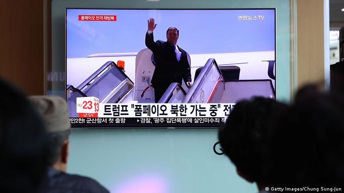 South Koreans watch on a screen reporting the U.S. Secretary of State Mike Pompeo visit to North Korea at the Seoul Railway Station on May 9, 2018 in Seoul, South Korea. (Getty Images/Chung Sung-Jun)