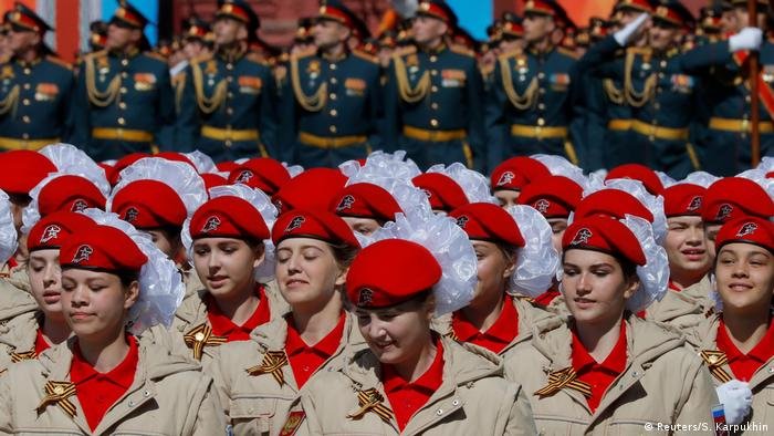 Female members of a youth military organization march in uniform (Reuters/S. Karpukhin)