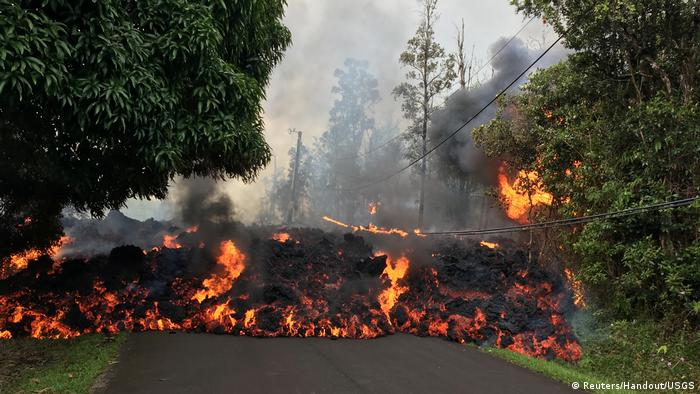 A lava flow from the Kilauea volcano, moves on a street in Leilani Estates in Hawaii (Reuters/Handout/USGS)