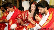 Tirupati, INDIA: Indian actors Abhishek Bachchan (R) and Aishwarya Rai (C) are accompanied by Amitabh Bachchan (C) as they take prasad (blessed food)during a visit to The Lord Venkatesh Wara Temple at Tirupati,some 550 kms south of Hyderabad, 22 April 2007. Bollywood stars Aishwarya Rai and Abhishek Bachchan began life as Mr and Mrs Bachchan 21 April, after three days of wedding celebrations for Indian cinema's ultimate power couple. AFP PHOTO/NOAH SEELAM (Photo credit should read NOAH SEELAM/AFP/Getty Images)