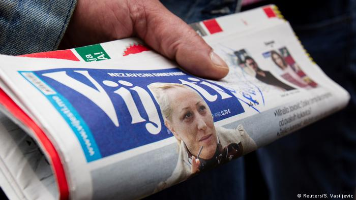 Folded newspaper with the face of Olivera Lakic on the front page (Reuters/S. Vasiljevic)