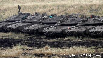 Israeli tanks wait in a field (Getty Images/AFP/J. Marey)