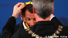 10.05.2018+++ French President Emmanuel Macron receives the Charlemagne Prize from Marcel Philipp, mayor of Aachen during a ceremony in Aachen, Germany May 10, 2018. REUTERS/Wolfgang Rattay