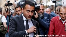 10.05.2018 Five-Star Movement (M5S) leader Luigi Di Maio walks in downtown Rome after a meeting with the leader of the League Matteo Salvini Thursday, May 10, 2018. League leader Matteo Salvini, who heads the center-right bloc, and 5-Star leader Luigi di Maio said in a joint statement after a face-to-face meeting in Rome that they had reached ''significant progress'' on the composition of the Cabinet and on identifying a candidate for the post of premier. (Giuseppe Lami/ANSA via AP)