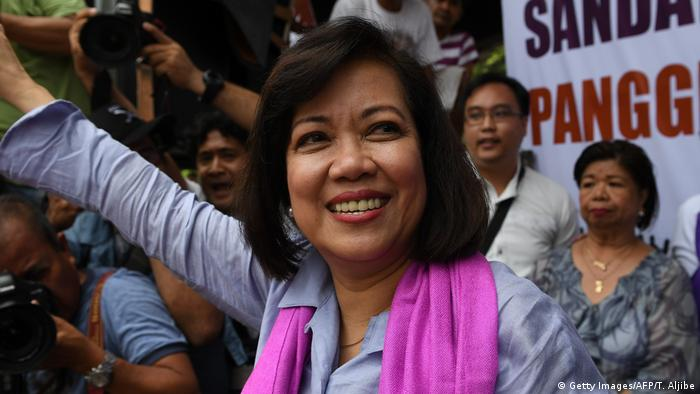 Ousted Philippine Supreme Court Chief Justice Maria Lourdes Sereno waves to supporters in front of the supreme court building in Manila.
