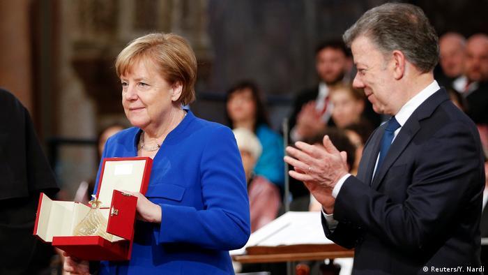Ангела Меркель и Хуан Мануэль Сантос в Ассизи, 12 мая 2018 года