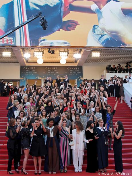 Film industry women protest on the steps of Cannes, raising their fists in the air (Reuters/J.-P. Pelissier)