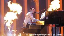 Melovin from Ukraine performs the song 'Under The Ladder' in Lisbon, Portugal, Saturday, May 12, 2018 during the Eurovision Song Contest grand final. (AP Photo/Armando Franca) |