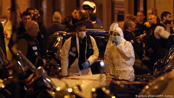 Investigators at the scene of the Paris attack