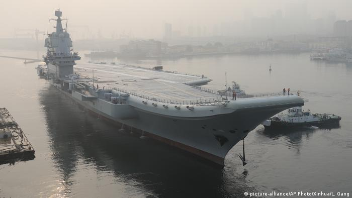 First Chinese-built aircraft carrier takes to the waves for trials