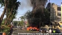 Motorcycles burn following a blast at the Pentecost Church Central Surabaya (GPPS), in Surabaya, East Java, Indonesia May 13, 2018, in this photo provided by Antara Foto. Antara Foto/ Handout Surabaya Government/ via REUTERS ATTENTION EDITORS - THIS IMAGE WAS PROVIDED BY A THIRD PARTY. MANDATORY CREDIT. INDONESIA OUT.