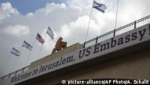 A sign on a bridge leading to the US Embassy compound ahead the official opening in Jerusalem, Sunday, May 13, 2018. Monday's opening of the U.S. Embassy in contested Jerusalem, cheered by Israelis as a historic validation, is seen by Palestinians as an in-your-face affirmation of pro-Israel bias by President Donald Trump and a new blow to frail statehood dreams. (AP Photo/Ariel Schalit) |
