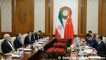 13.05.2018 *** Chinese State Councillor and Foreign Minister Wang Yi (R) holds talks with Iranian Foreign Minister Mohammad Javad Zarif (L) at the Diaoyutai state guesthouse in Beijing on May 13, 2018. - Iran's foreign minister arrived May 13 in Beijing on the first leg of a whirlwind diplomatic tour designed to try and rescue the nuclear deal left on the brink of collapse after the US pulled out. (Photo by THOMAS PETER / POOL / AFP) (Photo credit should read THOMAS PETER/AFP/Getty Images)
