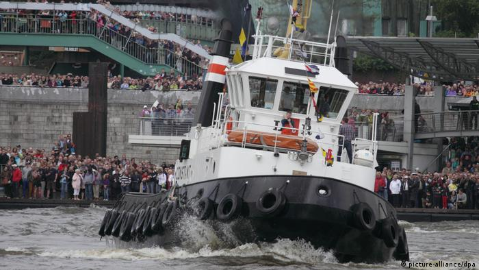 A tugboat taking part in a ballet performance during Hamburg Port anniversary celebrations