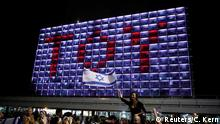 People celebrate the winning of the Eurovision Song Contest 2018 by Israel's Netta Barzilai with her song Toy , at Rabin square in Tel Aviv, Israel, May 13, 2018. REUTERS/Corinna Kern