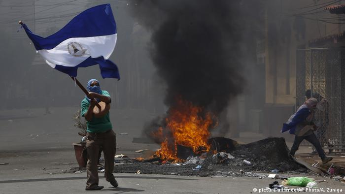 Protesters burn a barrivade in the city of Masaya