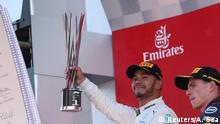 Formula One F1 - Spanish Grand Prix - Circuit de Barcelona-Catalunya, Barcelona, Spain - May 13, 2018 Mercedes' Lewis Hamilton celebrates on the podium with his trophy after winning the race REUTERS/Albert Gea